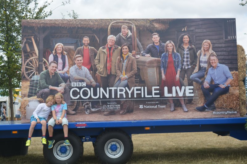 boys sat in from of BBC Country File Live 2018 poster