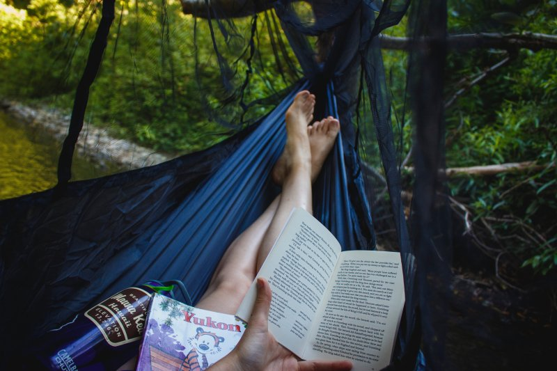 reading book in hammock