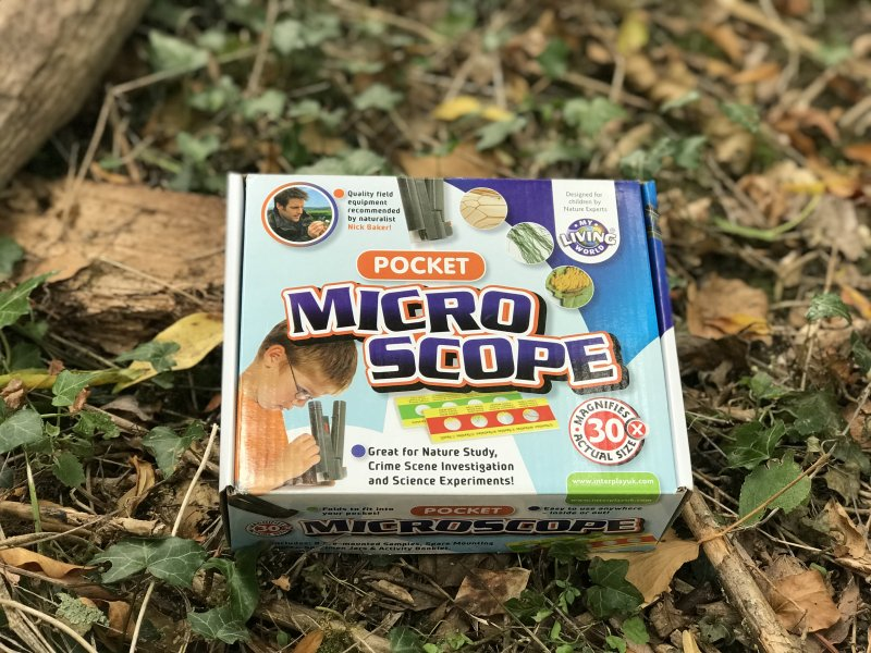 my living world pocket micro scope box outside in the leaves