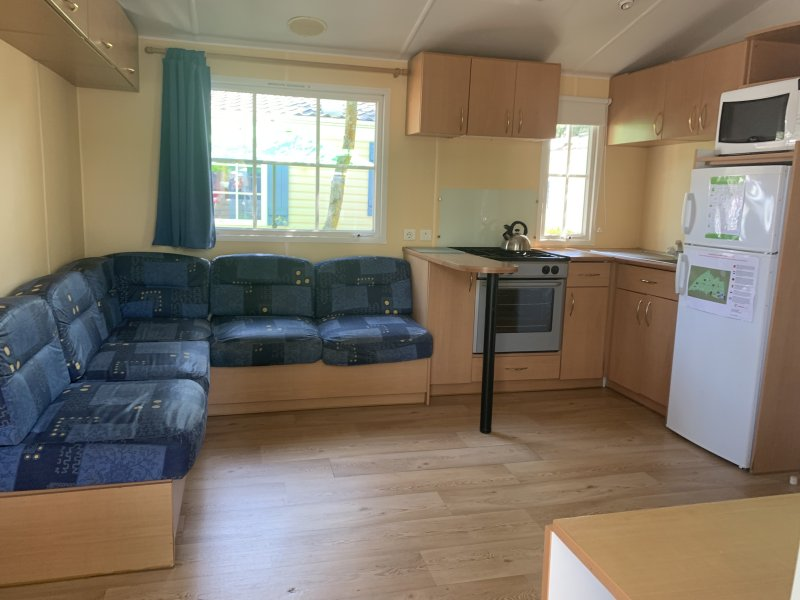 main living area at Eurocamp accommodation with the sun holidays at camping les  Genêts