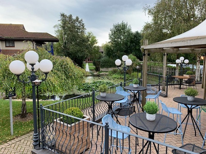 outside seating at The Aztec West Hotel & Spa