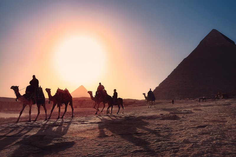 The view in Egypt of pyramids and camels