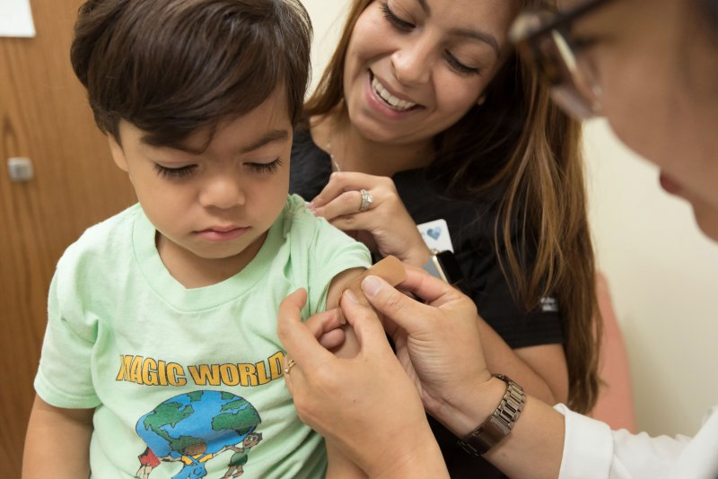 boy after immunisation, picture with no needles in