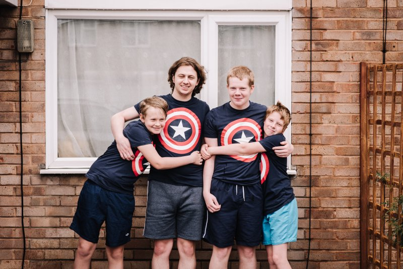 4 boys in matching Marvel tops