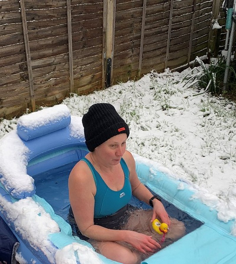 cold water therapy bath in the snow