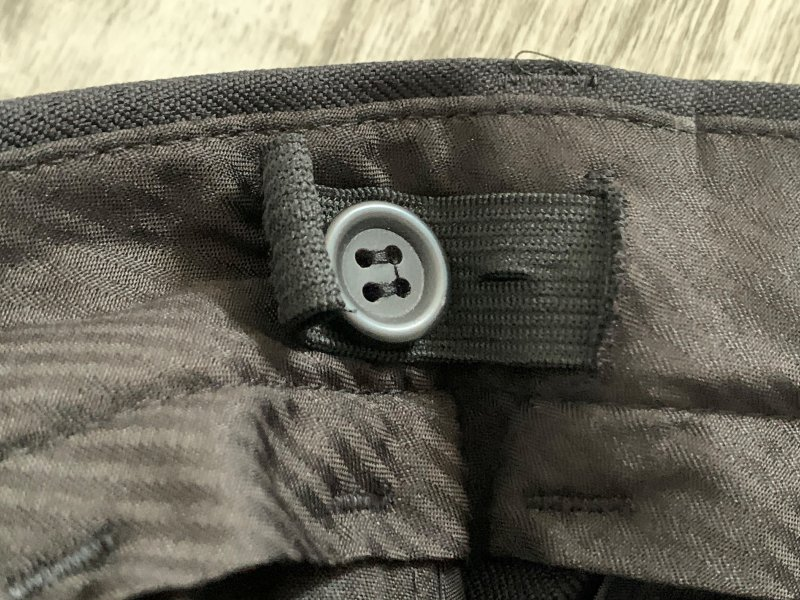buttons to control the waist size on school trousers