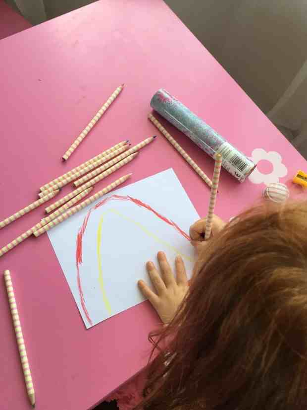Ava drawing a rainbow picture
