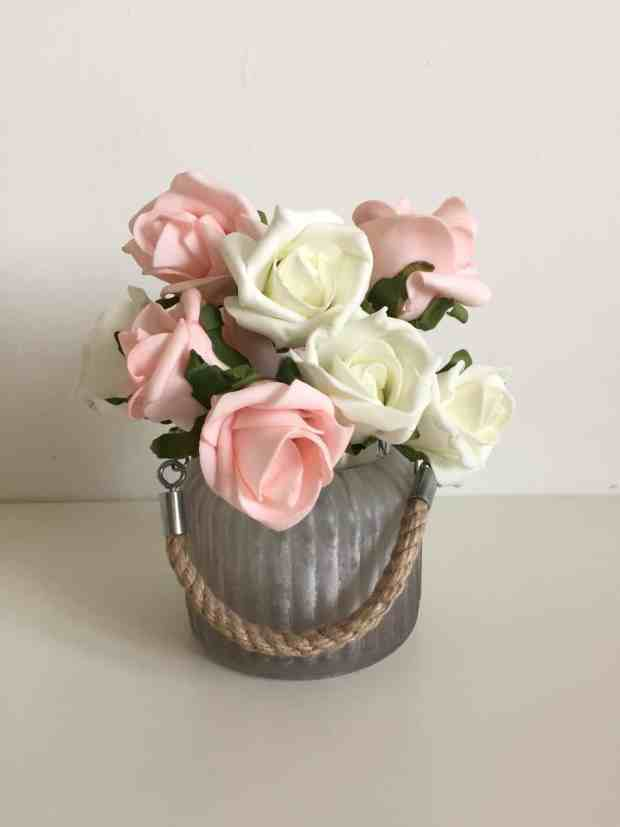 Frosted glass tealight holder and faux roses