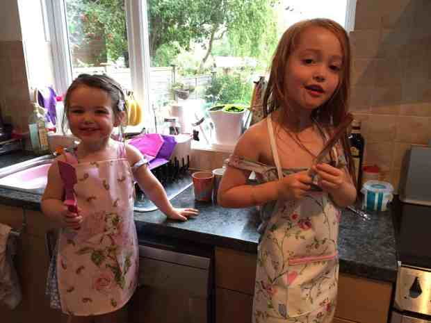 Thea and Ava helping make brownies