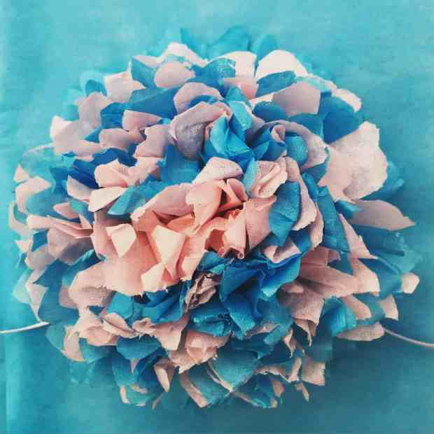 The finished pink and turquoise pom pom!