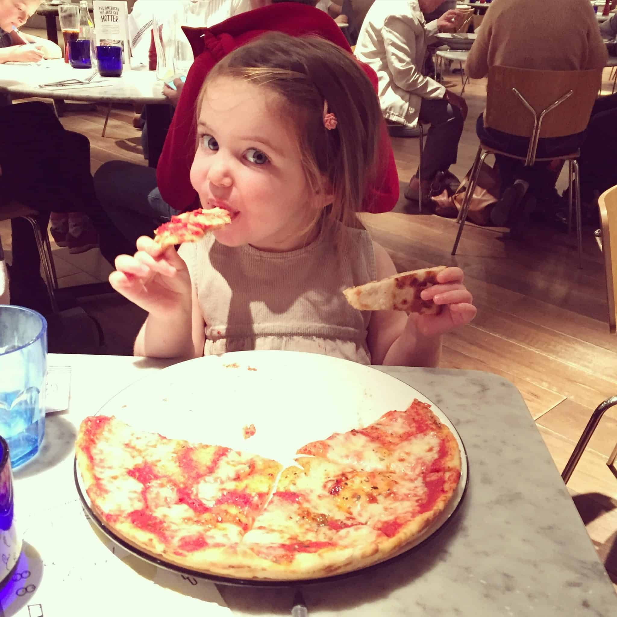 Thea enjoying pizza at Pizza Express