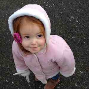 Ava in the snow aged two