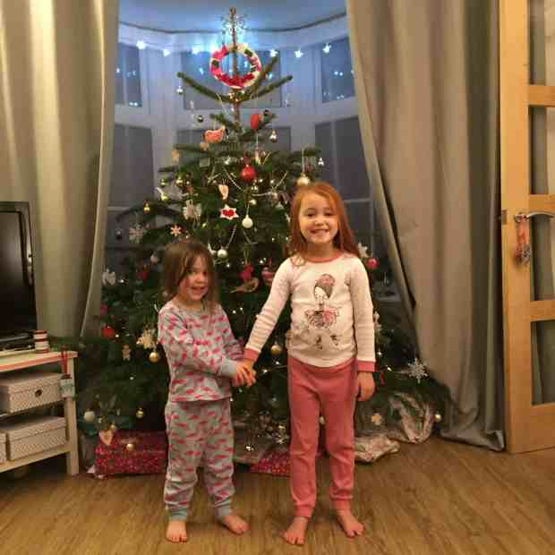 Thea and Ava in front of our Christmas Tree