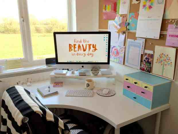 Home office with IKEA curved desk, Mac, pastel drawers and pinboard
