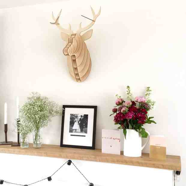 Mantlepiece with stag's head, flowers and Wedding Picture from Bespoke & Oak Co