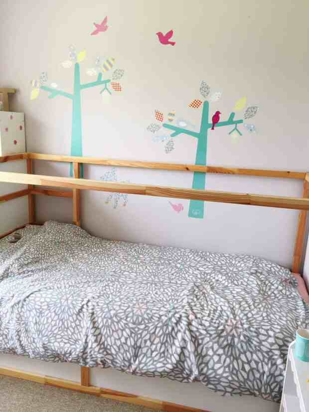 Ikea Kura Bed with grey duvet cover and Little Bird turquoise tree wall decals