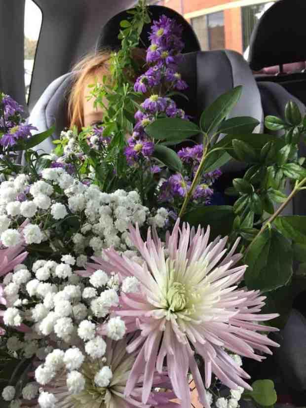 Ava carrying Grandma's birthday flowers