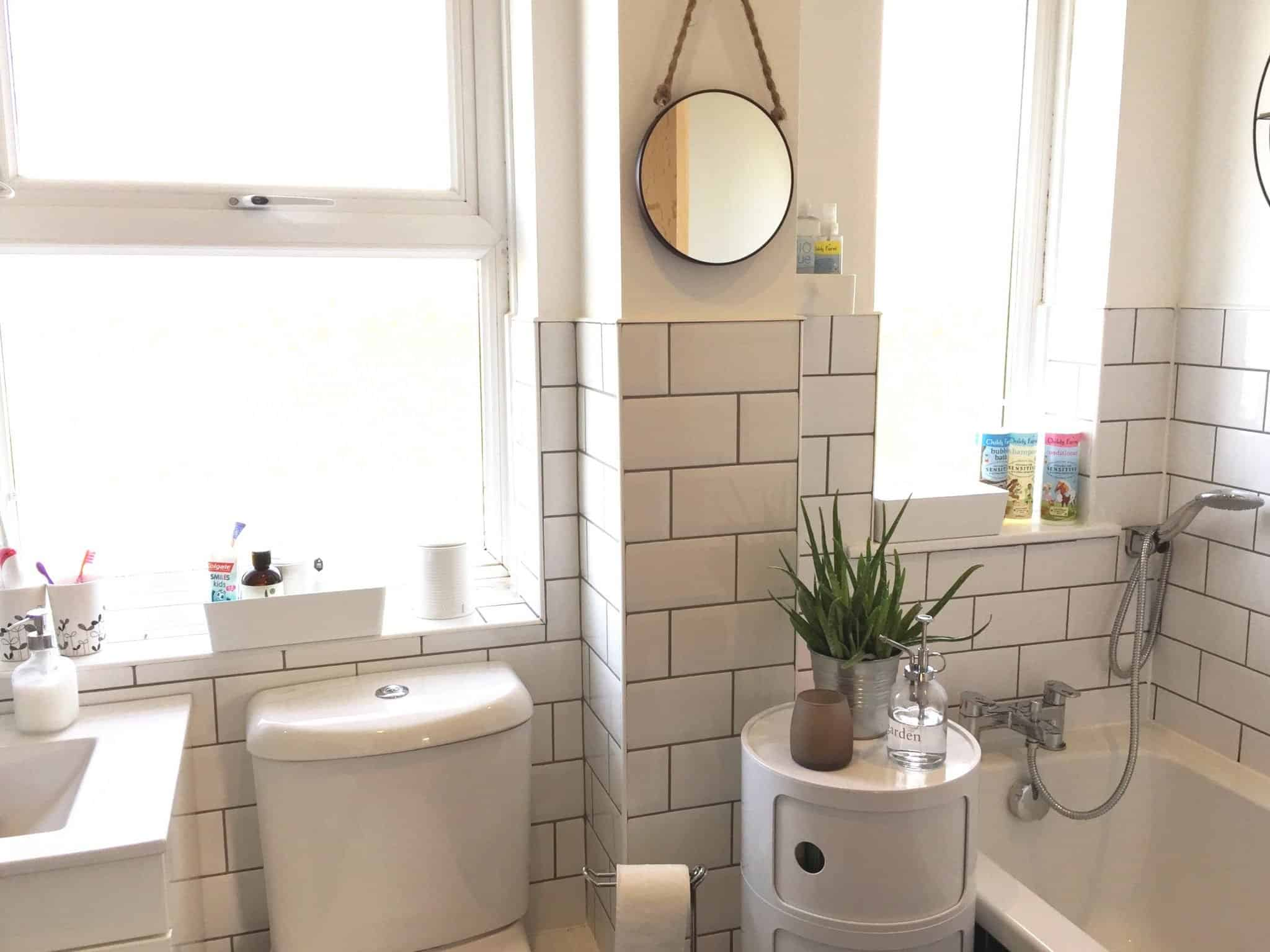 White bathroom with white metro tiles and grey grout
