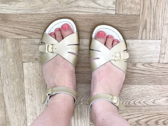 Classic Gold Salt-Water Sandals on parquet floor
