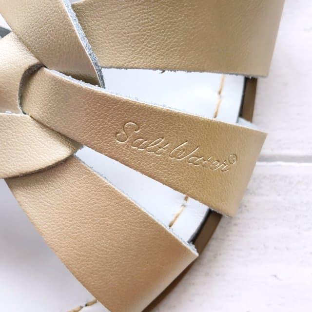 Gold Original Salt-Water Sandals Logo
