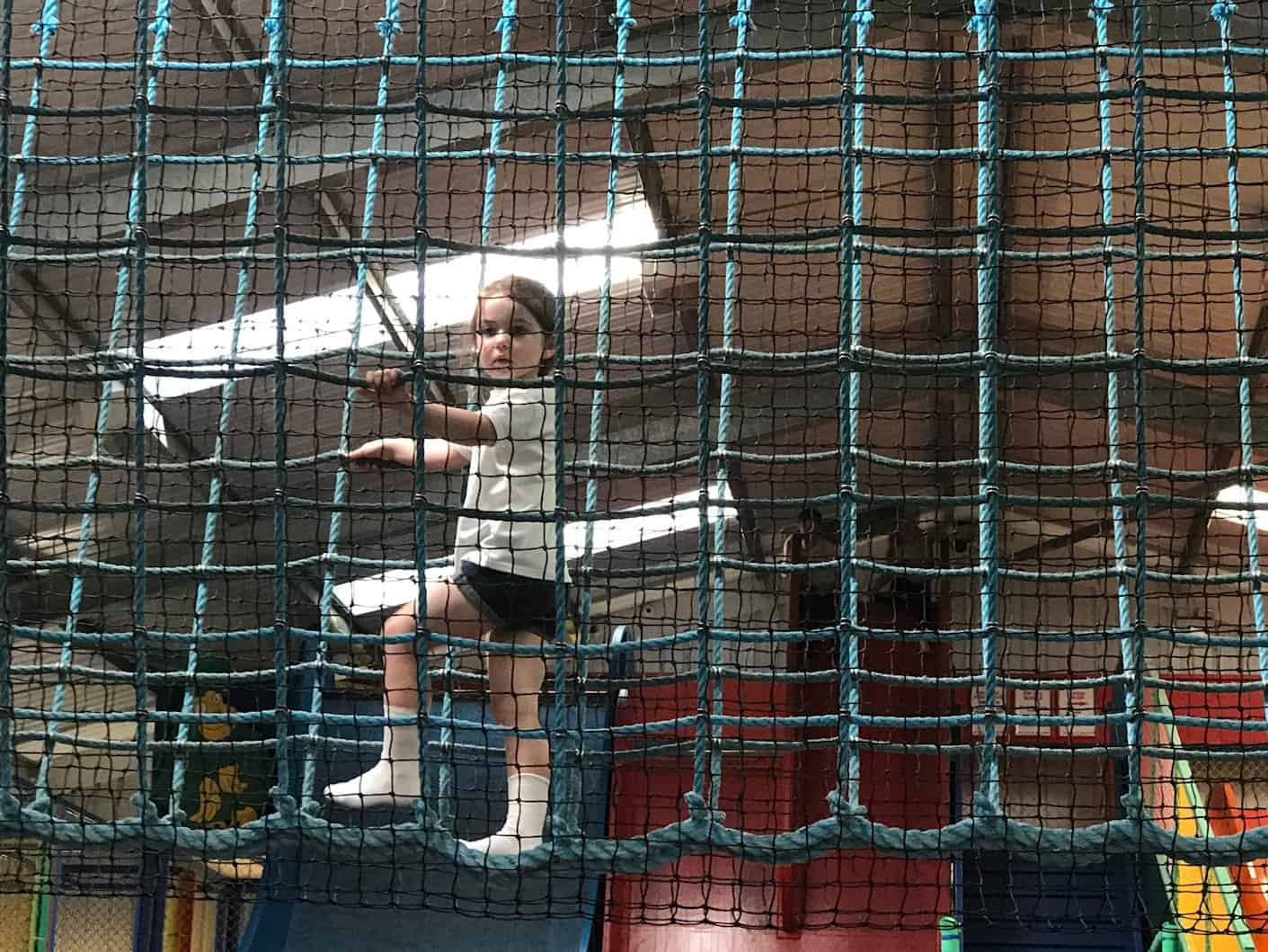 Thea climbing at the play barn