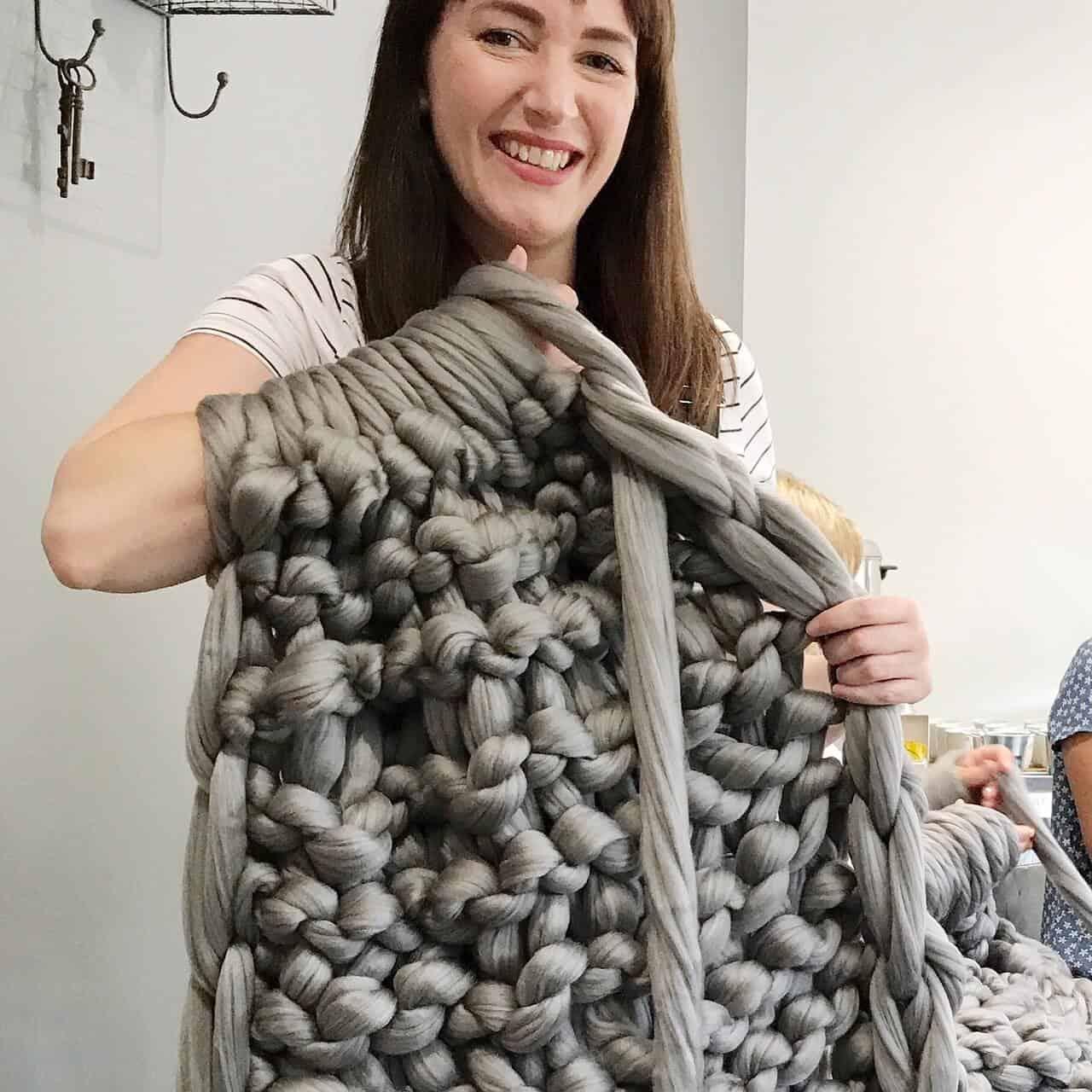 Becky Pink Arm Knitting a Throw