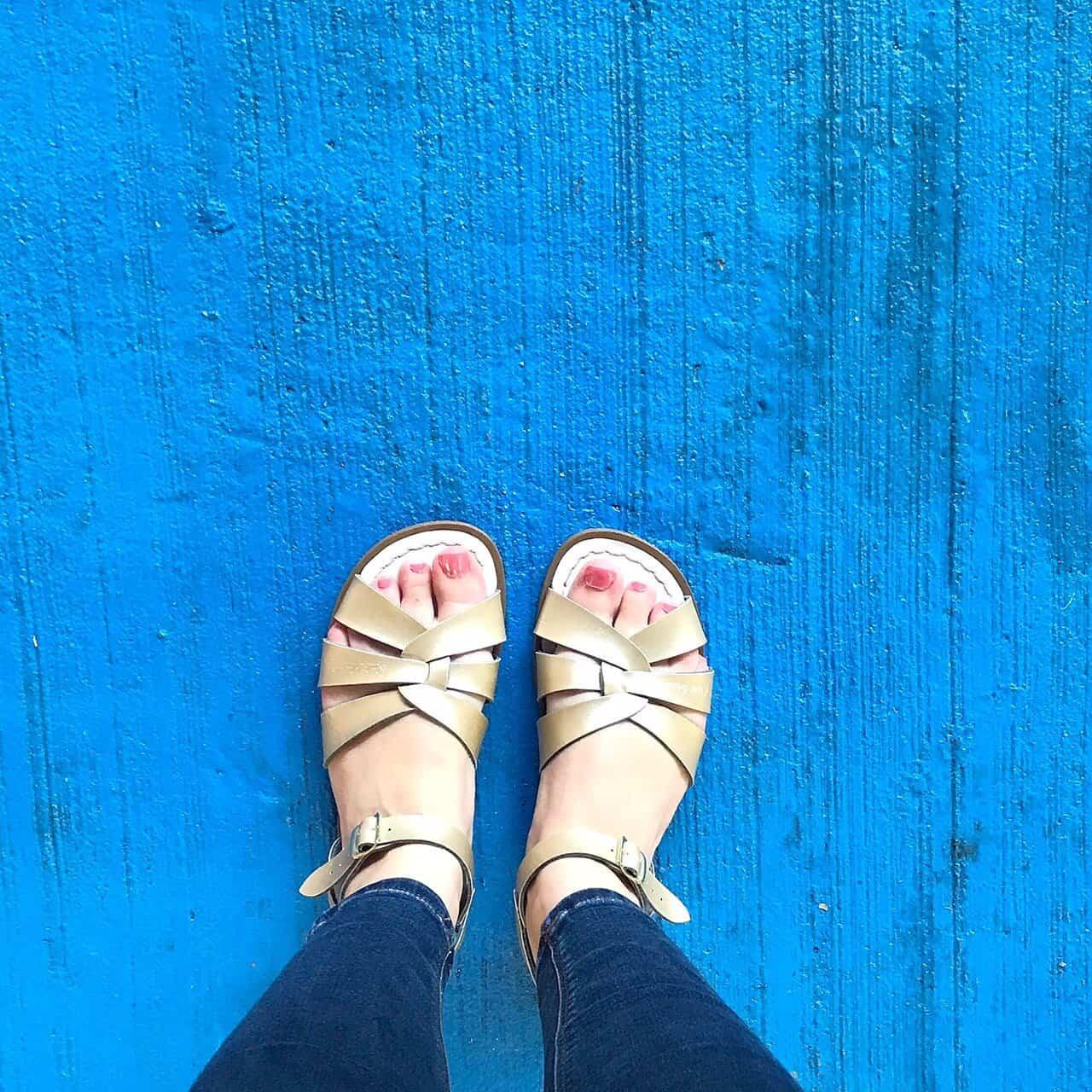 Original Gold Salt-Water Sandals on a blue floor