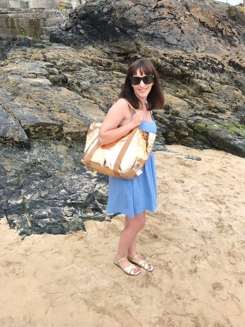 Rose Gold My Paper Tote being carried on a beach