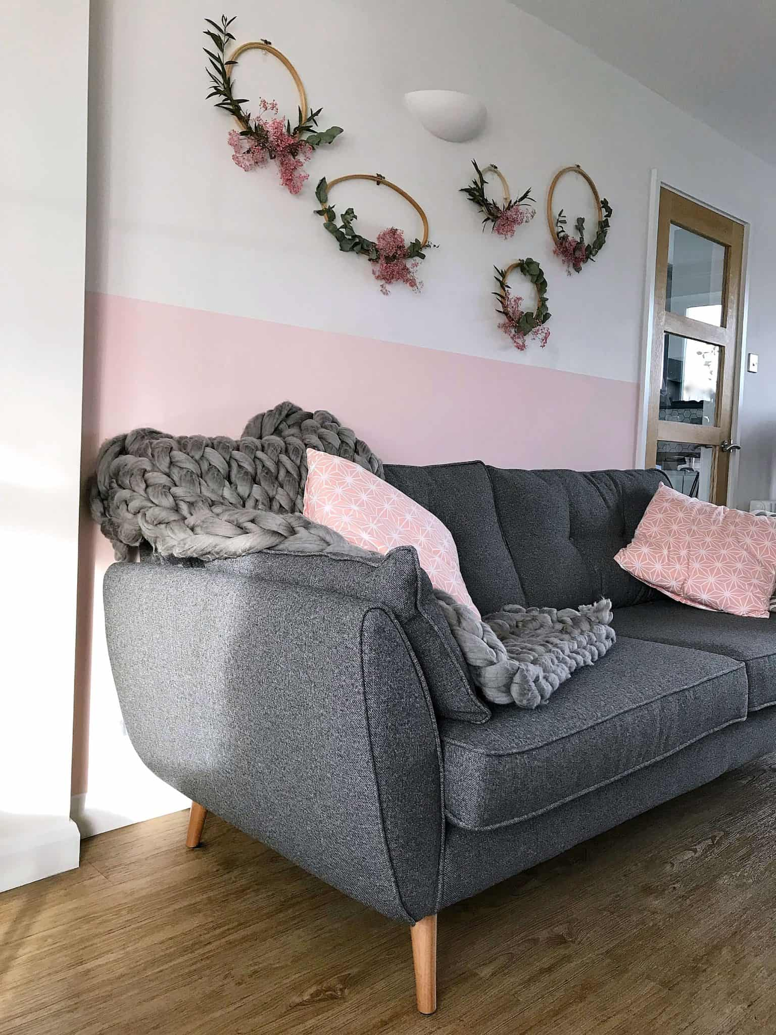 Charcoal Zinc DFS sofa with pink wall and cushions
