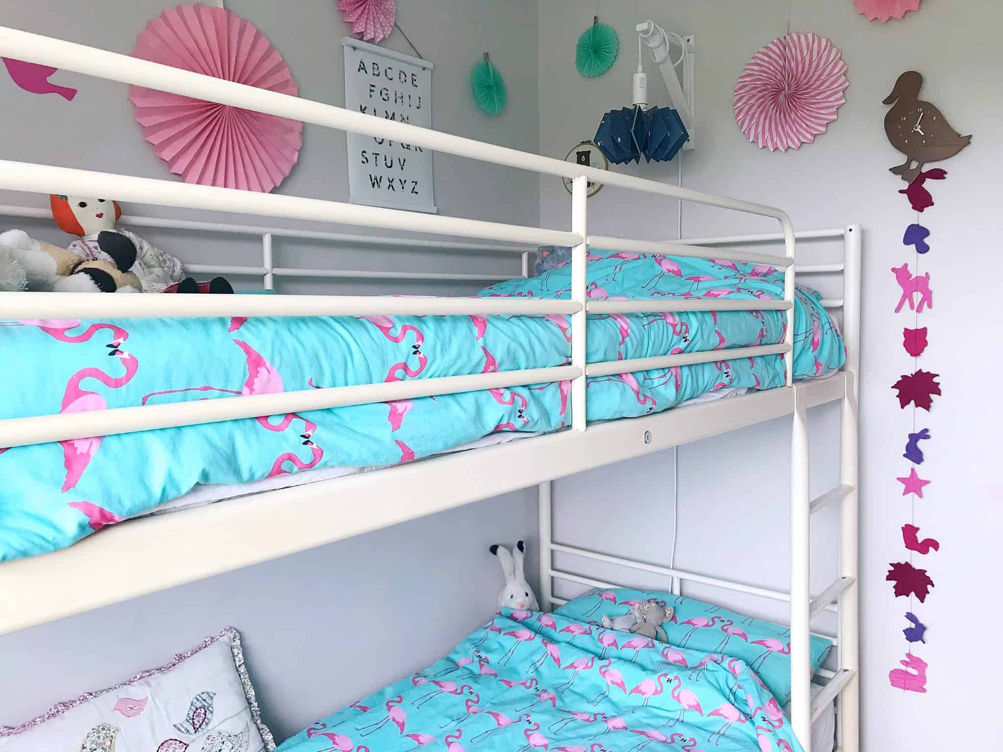 A girls shared bedroom with bunk beds
