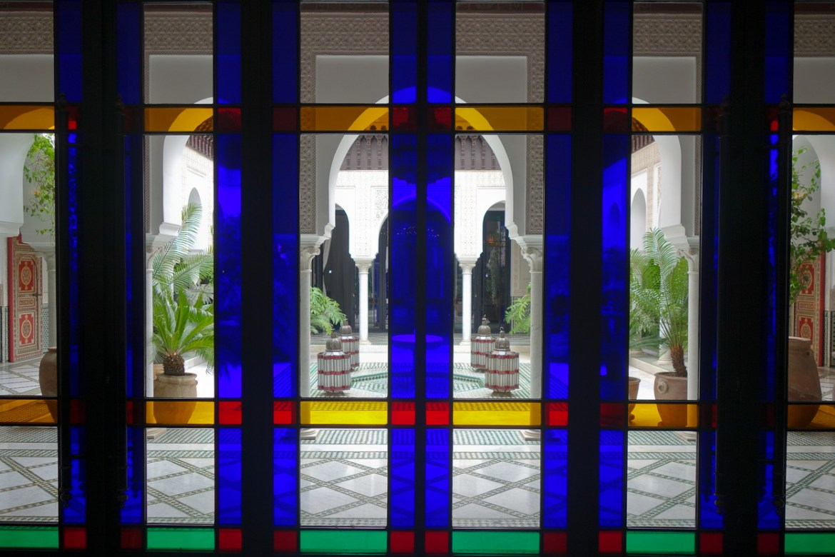 View through stained glass windows onto the spa courtyard at La Mamounia hotel, Marrakech