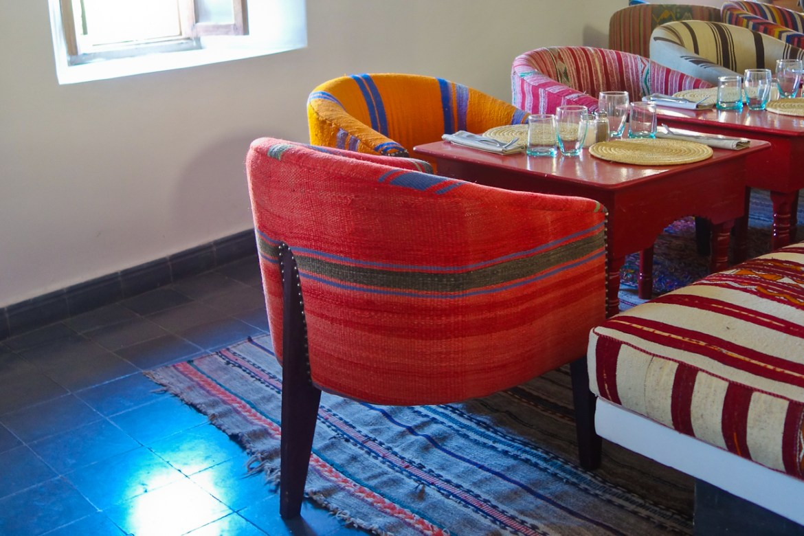 Colourful tapestry chairs at Nomad restaurant, Marrakech