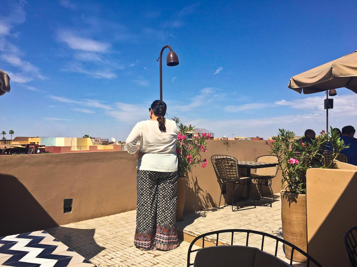 pinkschmink taking in the view of the medina from the rooftop terrace at Nomad restaurant, Marrakech