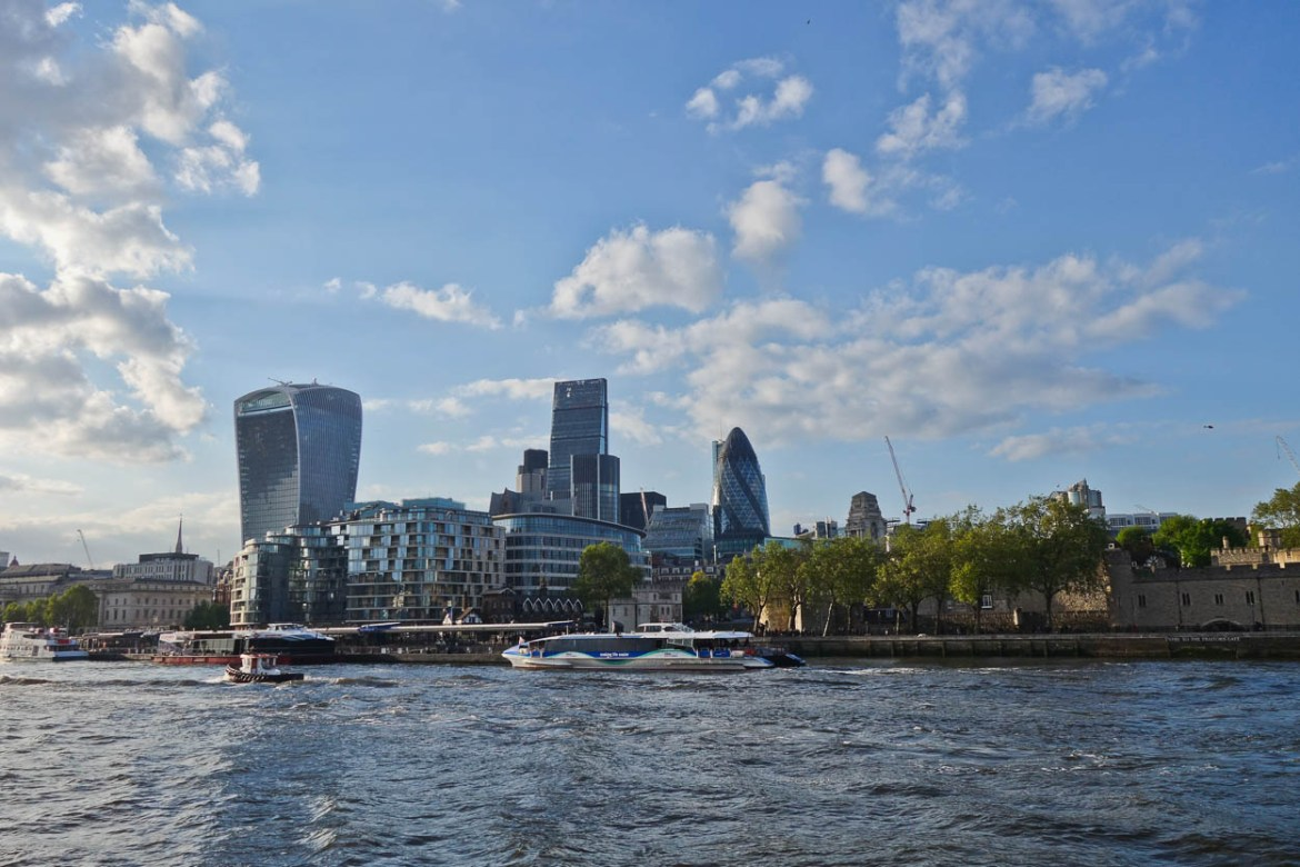 The Gherkin, the Walkie-Talkie and the Cheese Grater buildings in the City of London seen from the Thames