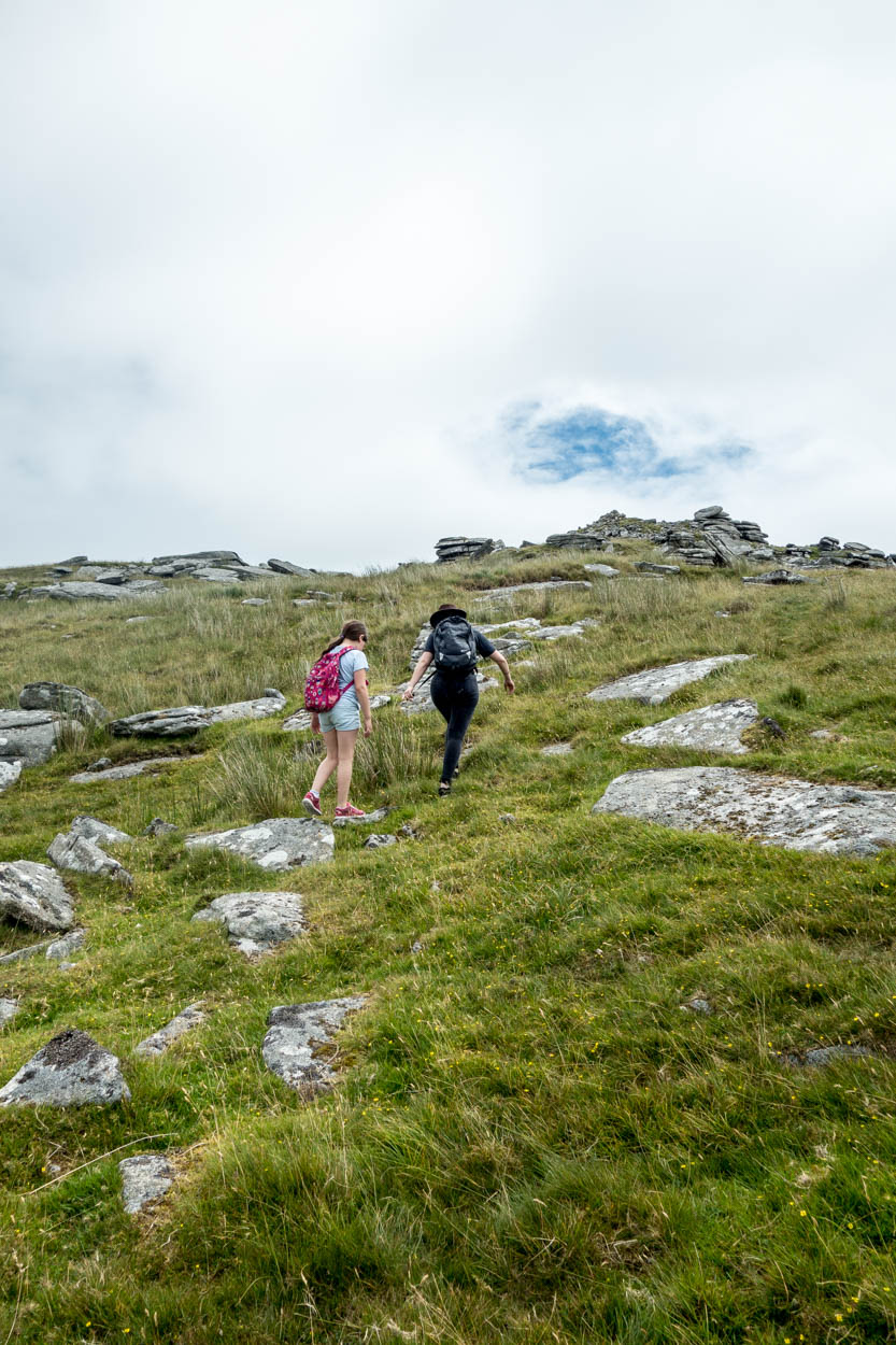 Miss France and Laura hike up to Little Rough Tor on Bodmin Moor, Cornwall