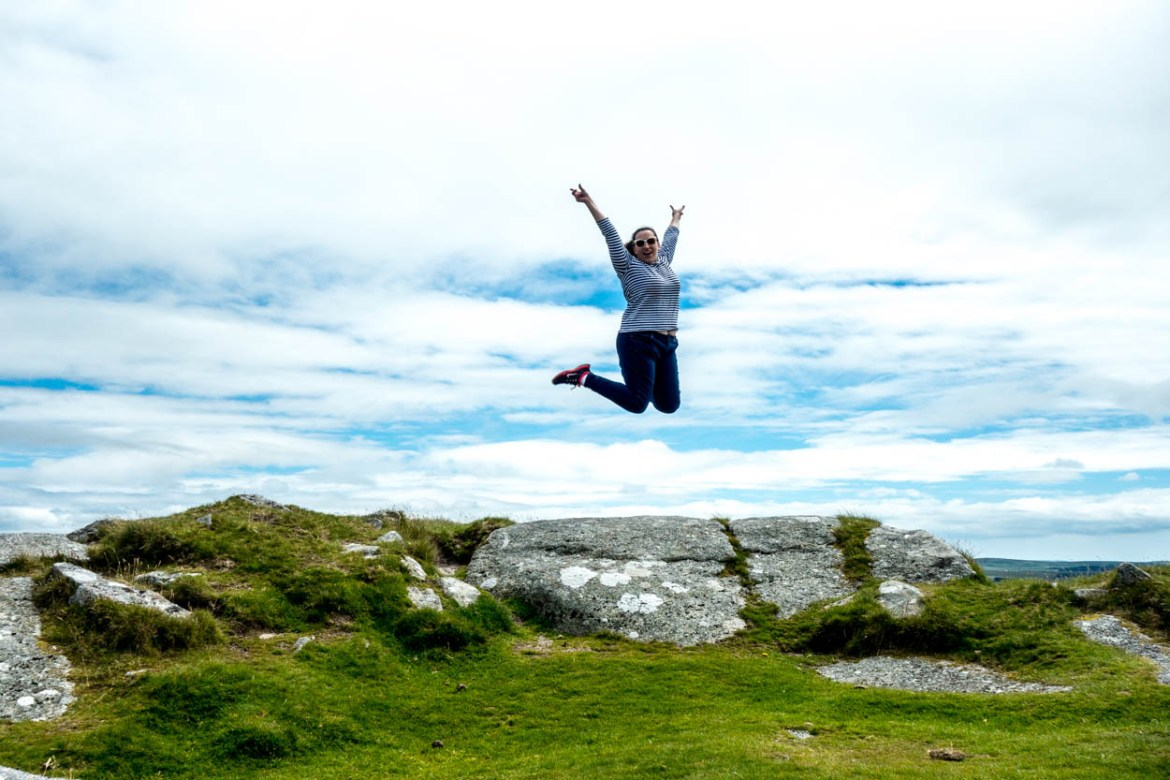 pinkschmink jumps at the top of Rough Tor on Bodmin Moor, Cornwall