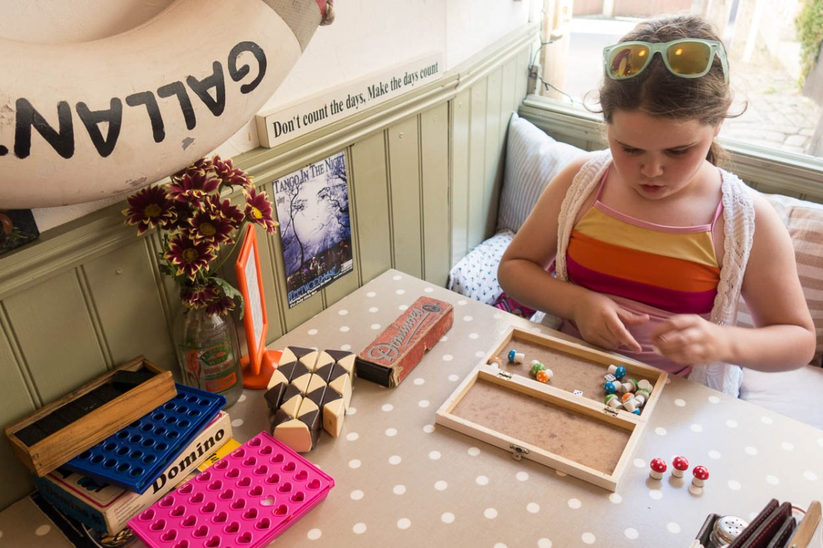 Miss France playing board games at the Lifebuoy Cafe, Cornwall