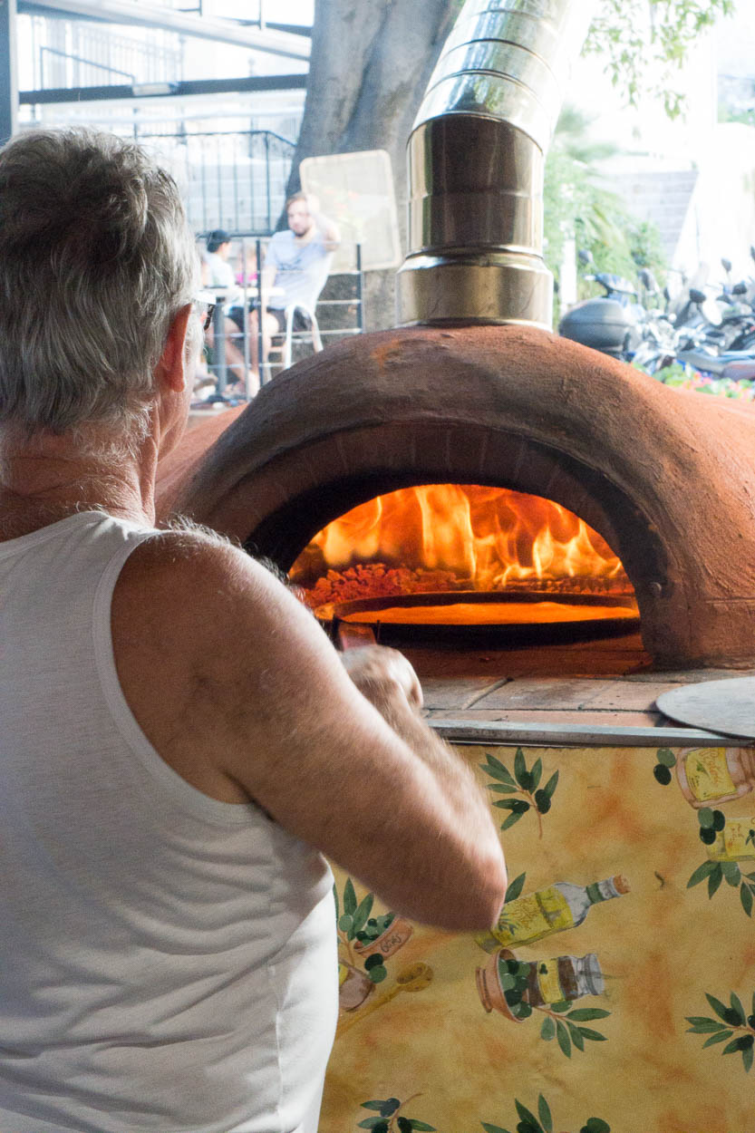 Traditional flatbreads being baked at the Provençal Market, Antibes