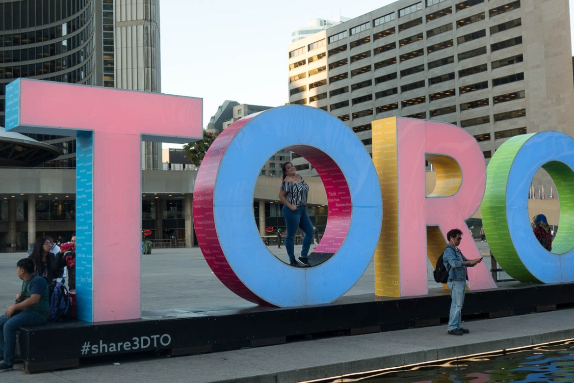 pinkschmink posing in the Toronto sign