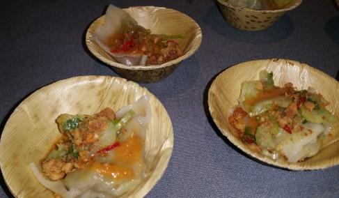 goat dumplings peanuts piri piri with corriander salad