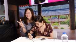 Sue signs my Korea Travel Guide Book from KTO Manila
