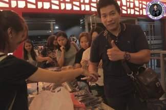 Fabricated City Block Screening in Manila distribution of souvenir items, photo credits JCW Ph FB page