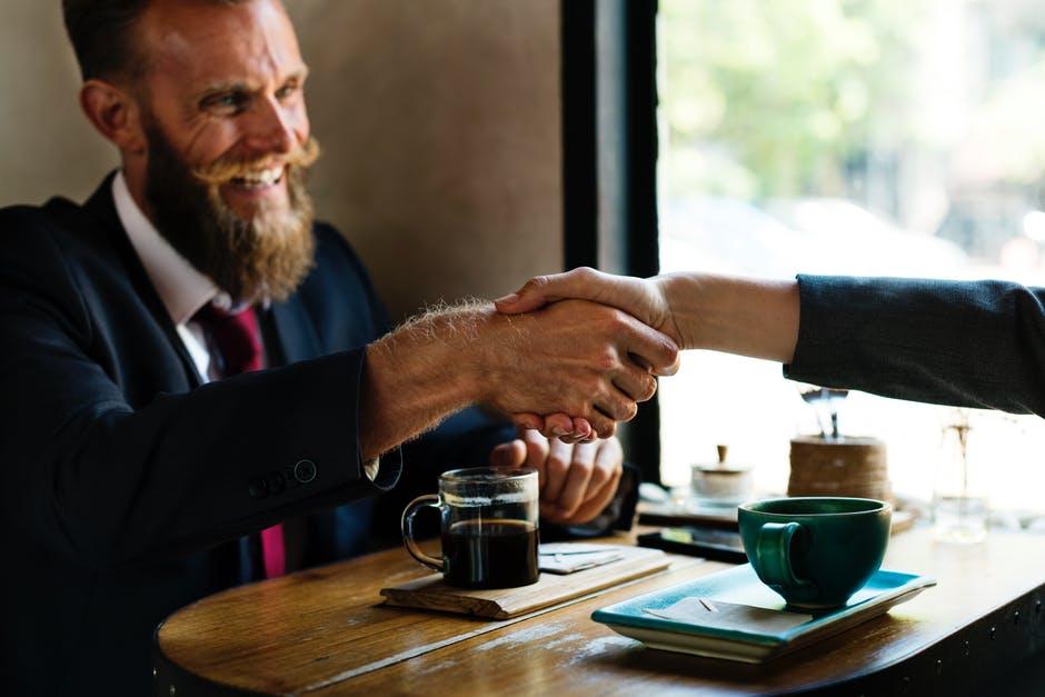 new employee shaking boss's hand