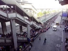 Queues going down the road as far as the eye can see are examples of some challenges the Philippines government face with an ever growing population.