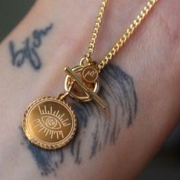 collier oeil spirituel tatouage