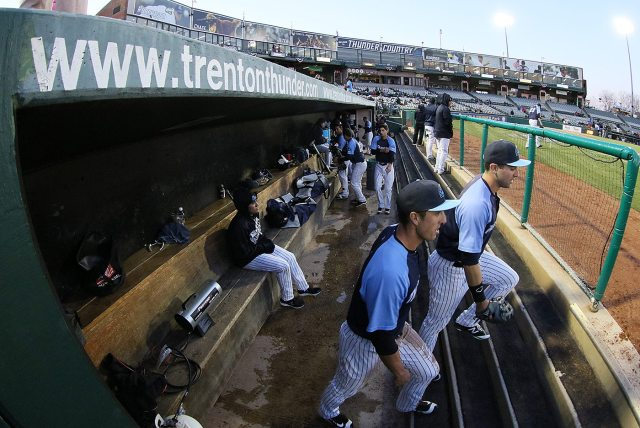 Trenton Thunder center fielder Lane Adams and left fielder Jake Cave head to the outfield for the top of the third inning against the Portland Sea Dogs at Arm & Hammer Park in Trenton on Tuesday, April 12, 2016. Photo by Martin Griff.