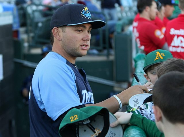 Trenton Thunder third baseman Dante Bichette Jr. signs autographs before a game against the Portland Sea Dogs at Arm & Hammer Park in Trenton on Tuesday, April 12, 2016. The 23 year old was selected by the New York Yankees in the second round of the 2011 First-Year Player Draft out of Orangewood Christian High School in Maitland, Florida. His father played for the Angels, Brewers, Rockies, Reds and Red Sox from 1988-2001. Photo by Martin Griff