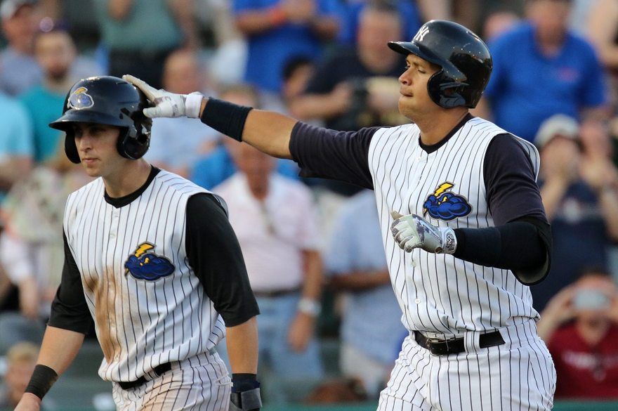 New York Yankees slugger Alex Rodriguez taps Trenton Thunder center fielder Dustin Fowler on the batting helmet after plating Fowler on a two run home run in the second inning at ARM & HAMMER Park in Trenton on Wednesday, May 25, 2016 during a game against the New Hampshire Fisher Cats. Rodriguez joined the Double A Yankee farm team for a second day as part of a rehab assignment. Photo by Martin Griff