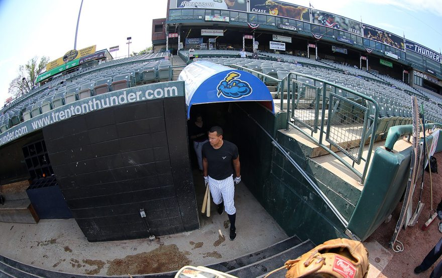 New York Yankees slugger Alex Rodriguez enters the dugout for batting practice with the Trenton Thunder at ARM & HAMMER Park in Trenton on Tuesday, May 24, 2016 before a game against the New Hampshire FisherCats. Rodriguez joins thr Double A team as part of a rehab assignment because of a hamstring injury Photo by Martin Griff