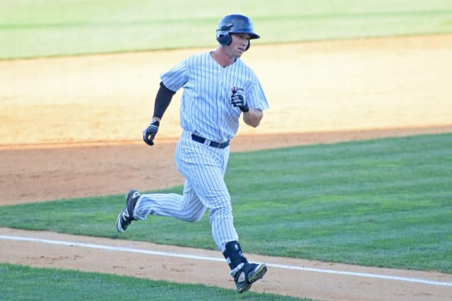 Drew Bridges rounds third and heads home after his solo homerun in the eighth inning. (Robert M. Pimpsner)